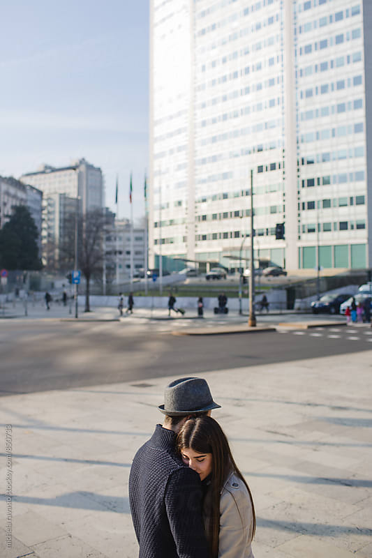 Young couple embracing in city by michela ravasio for Stocksy United
