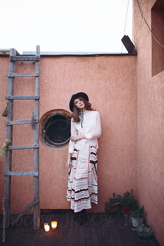 Bohemian woman posing  by Ani Dimi for Stocksy United