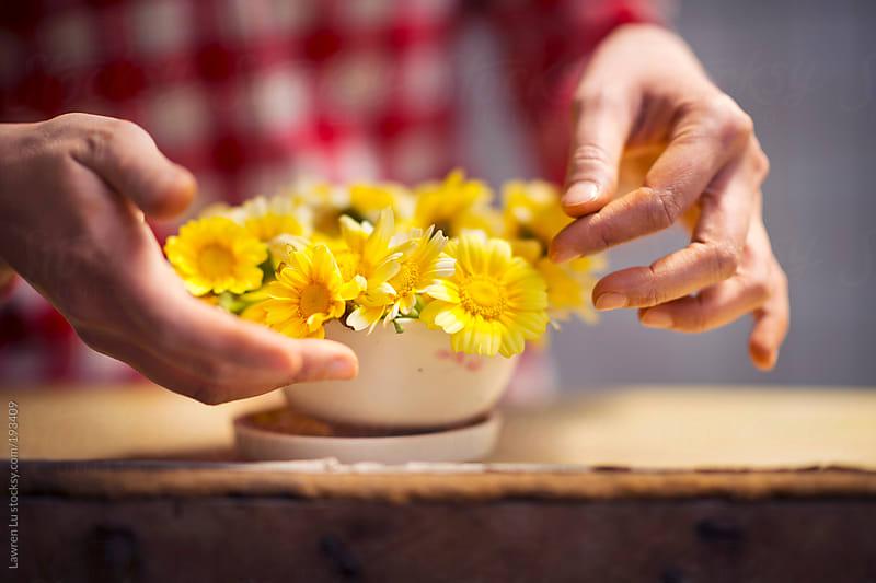 Making flowers bouquet in a pot by Lawren Lu for Stocksy United