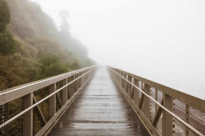 Foot bridge along the coast on a foggy morning,  by RZ CREATIVE for Stocksy United