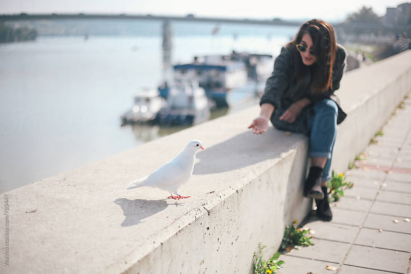 Stylish woman and  a white pigeon near the river  by VeaVea for Stocksy United
