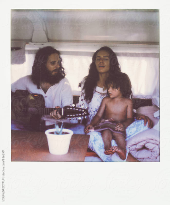 Polaroid of Young Hippie Family Singing Inside Camper Van by Julien L. Balmer for Stocksy United