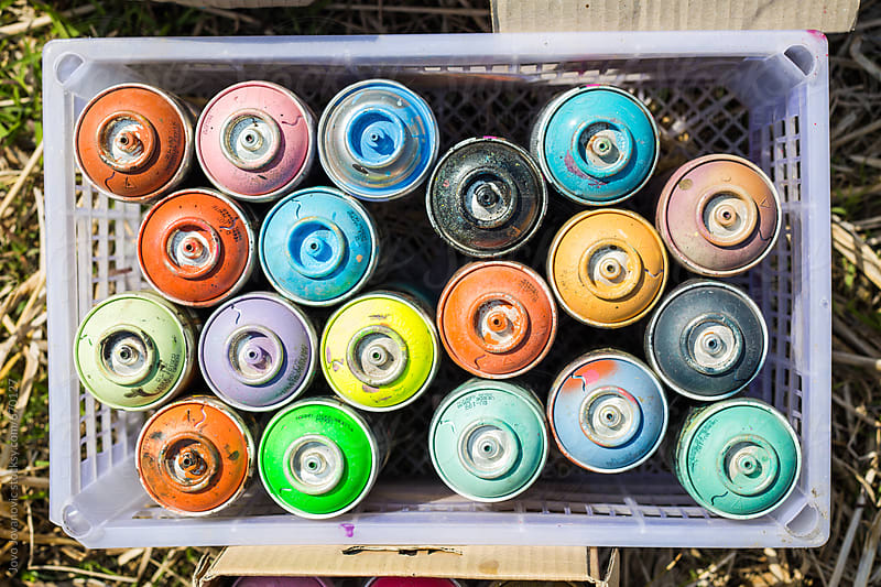 Plastic container full of spray paint cans by Jovo Jovanovic for Stocksy United