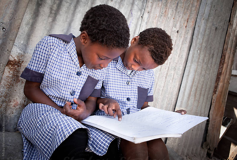 African Kids doing Homework by Micky Wiswedel for Stocksy United