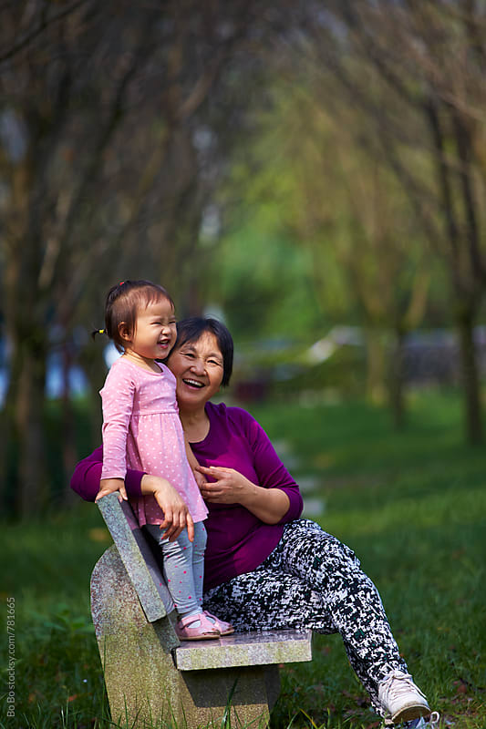 happy little asian girl outdoor with her grandmother in the park by Bo Bo for Stocksy United