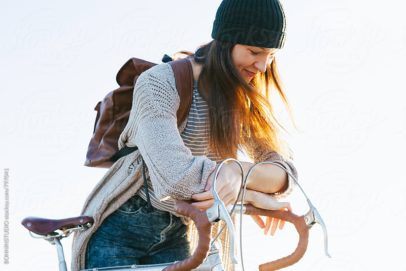 Young woman with her vintage bicycle enjoying a sunny day. by BONNINSTUDIO for Stocksy United