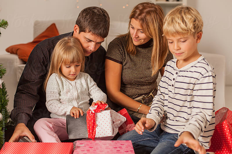 Happy Family with Christmas Gifts by Mosuno for Stocksy United
