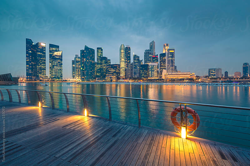 Singapore Skyline as seen from Marina Bay in the Evening by Tom Uhlenberg for Stocksy United