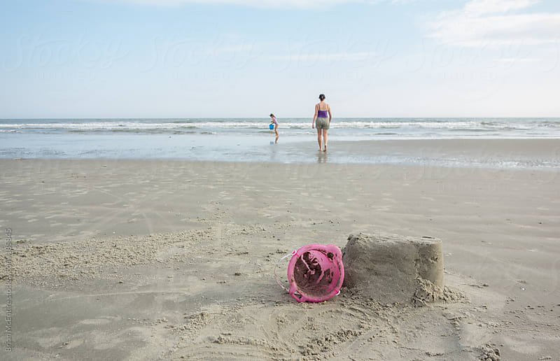 Mother and Daughter Build Sandcastle at the Beach by Brian McEntire for Stocksy United