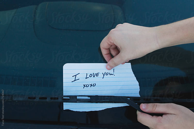 hand written love note placed on car windshield by Tana Teel for Stocksy United