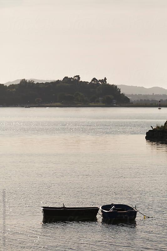 Boats at sunset by Marilar Irastorza for Stocksy United
