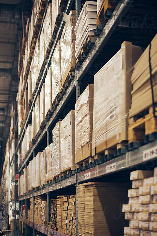 Packed Shelves in a Huge Warehouse  by Nemanja Glumac for Stocksy United