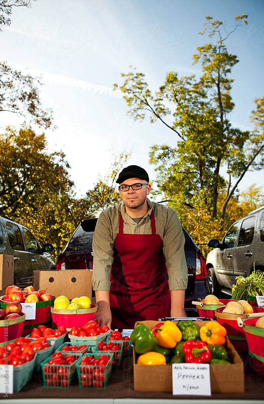 Farmer's Market: Man Serious About Selling at Market by Sean Locke for Stocksy United