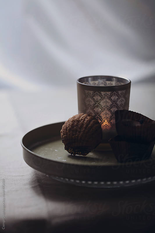 Honey-cinnamon ganache filled hazelnut shells by Csenge Dusha for Stocksy United