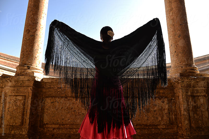 Flamenco dancer in Carlos V Palace, Granada by Bisual Studio for Stocksy United