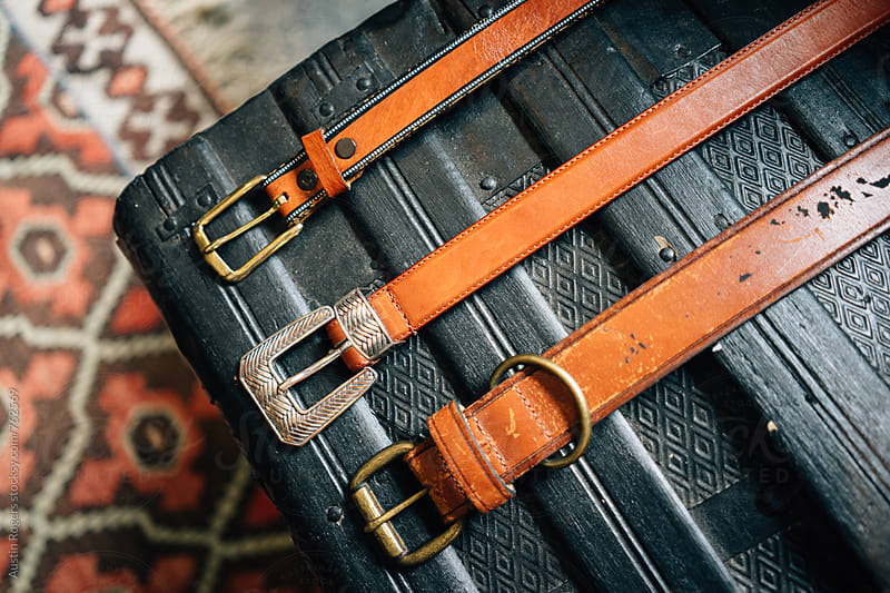 Belts on Black Wooden Chest by Austin Rogers for Stocksy United