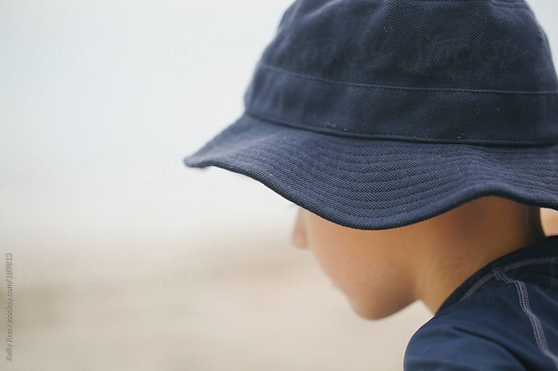 abstract portrait of a boy on the beach by Kelly Knox for Stocksy United