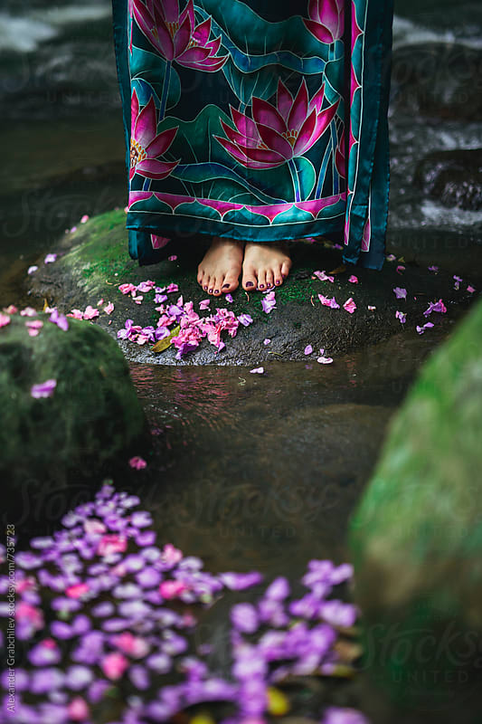 Woman Stands Barefoot On A Stone At A River by Alexander Grabchilev for Stocksy United