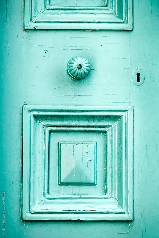 aqua colored ornate door with keyhole by Helen Yin for Stocksy United
