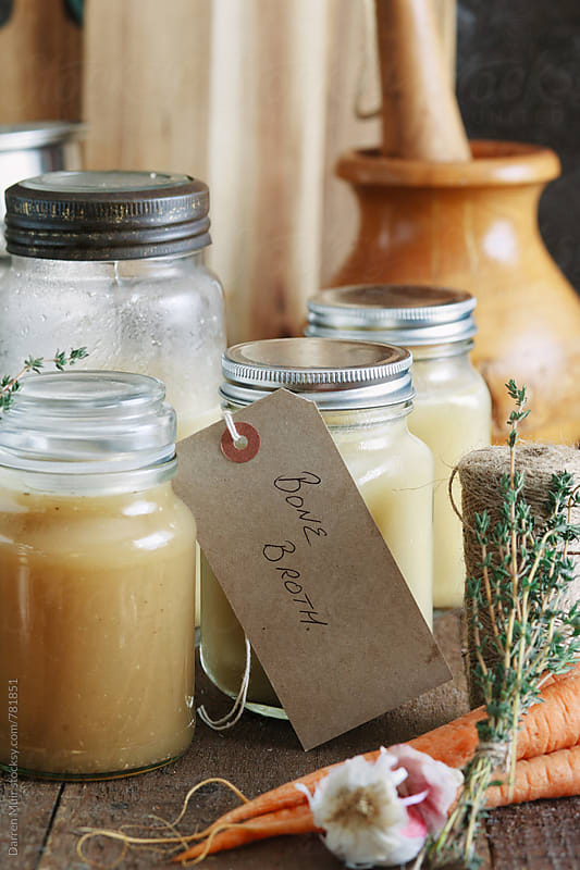 Bone broth: Closeup of various jars of bone broth. by Darren Muir for Stocksy United
