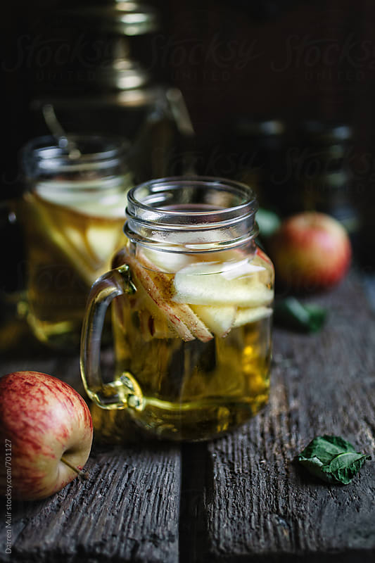 A tasty apple cider served in jars. by Darren Muir for Stocksy United