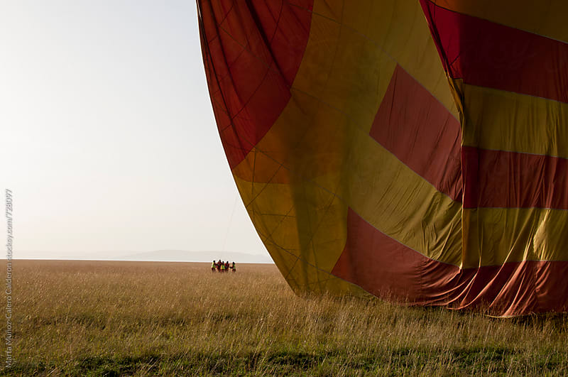 hot air balloon inflating by Marta Muñoz-Calero Calderon for Stocksy United
