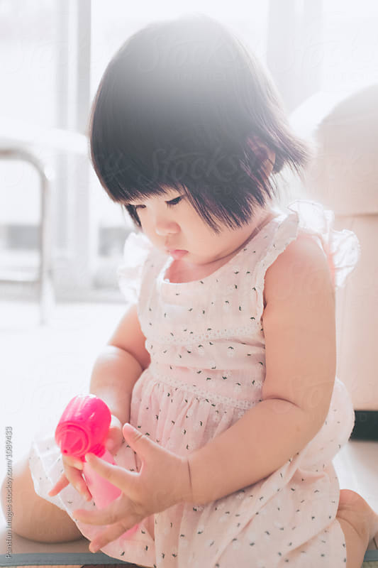 Asian baby girl at home by Xunbin Pan for Stocksy United