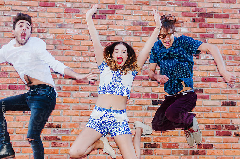 A group of young friends jumping in the air by Chelsea Victoria for Stocksy United