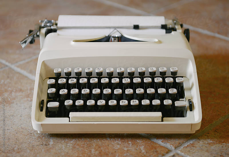 Vintage typewriter sitting on the floor by Emmanuel Hidalgo for Stocksy United