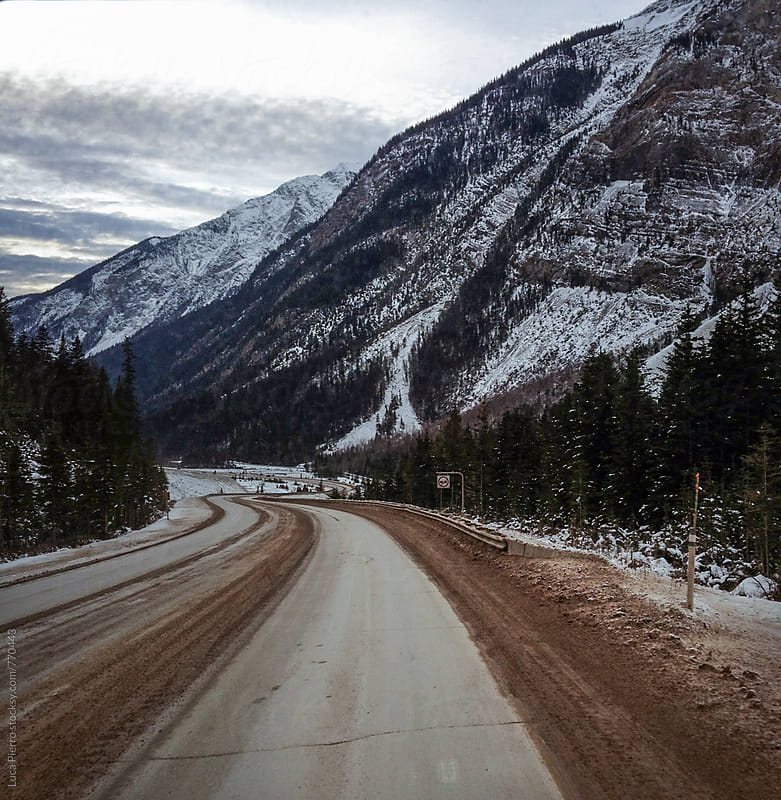 Lonely road in Alberta, Canada by Luca Pierro for Stocksy United