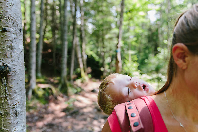 Child Asleep on Hike by Raymond Forbes LLC for Stocksy United