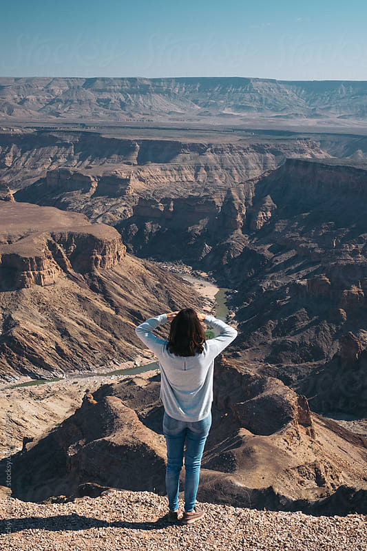 Woman at the edge of the Fish River Canyon by Micky Wiswedel for Stocksy United