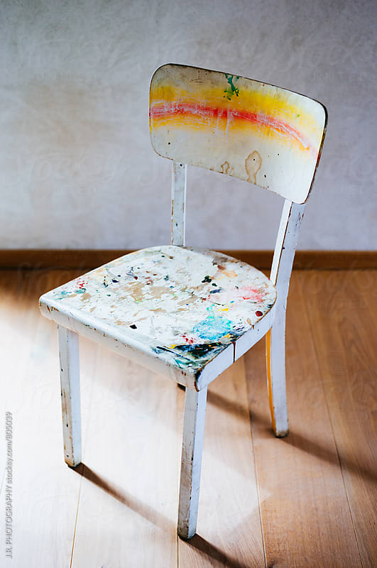 Splattered paint on empty chair by J.R. PHOTOGRAPHY for Stocksy United