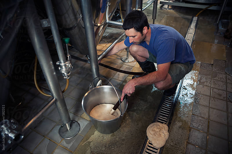 Beer: Taking A Bucketfull of Yeast by Sean Locke for Stocksy United