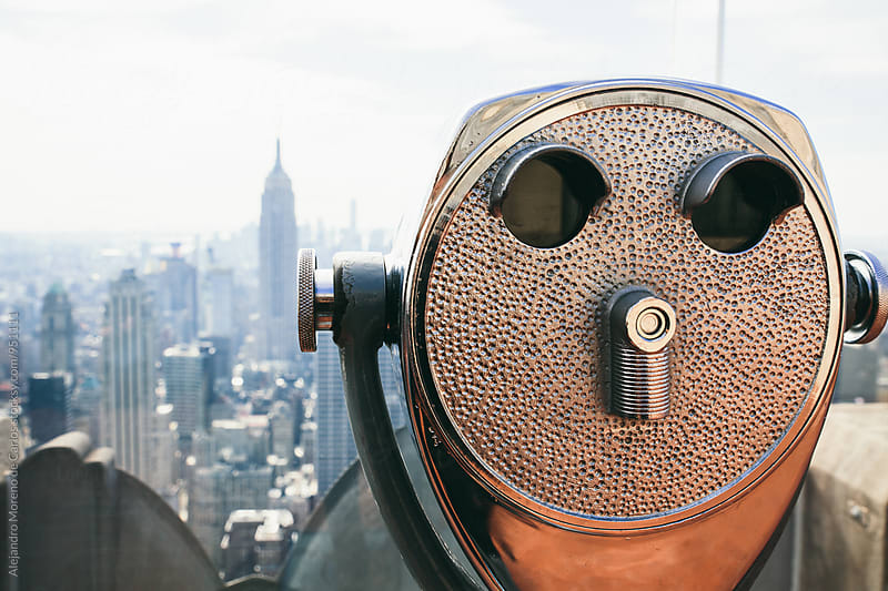 Binoculars against of beautiful New York cityscape by Alejandro Moreno de Carlos for Stocksy United
