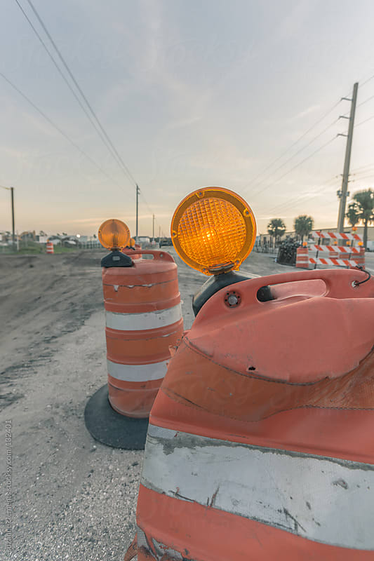 Construction Barricades along the Close Road at Sunset by suzanne clements for Stocksy United