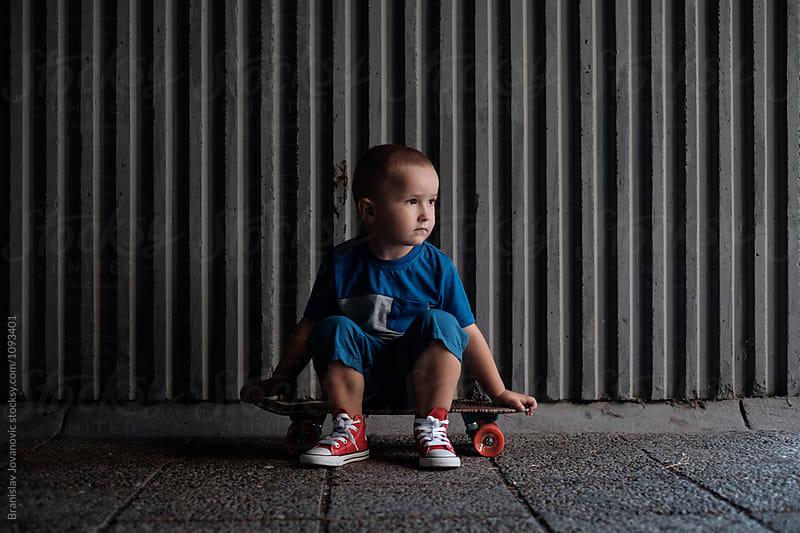 Kid Sitting on the Skateboard by Branislav Jovanović for Stocksy United