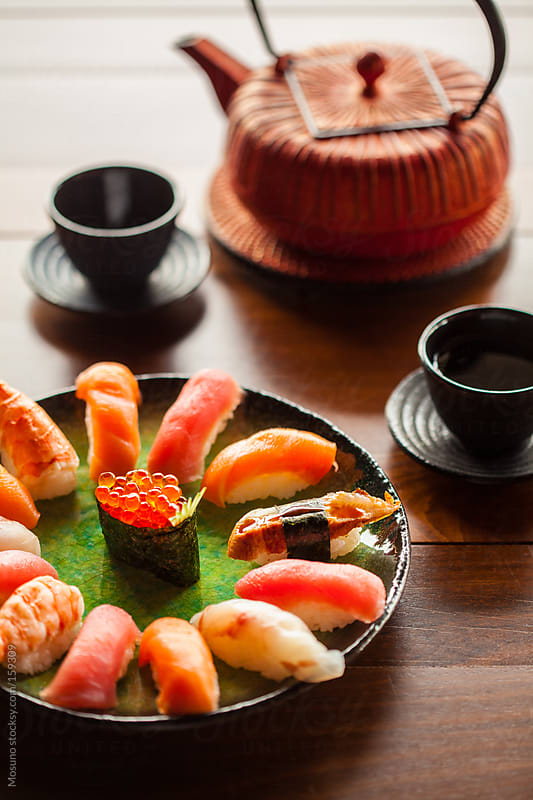 Sushi and Tea Served on the Table by Mosuno for Stocksy United