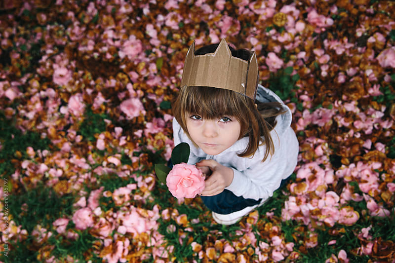 Child With A Flower by Ali Lanenga for Stocksy United