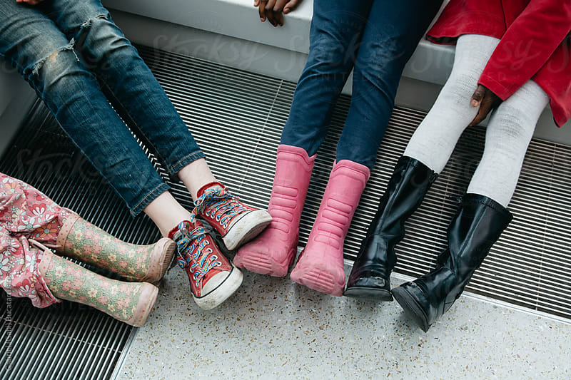 Boots and shoes of four young girls by Gabriel (Gabi) Bucataru for Stocksy United