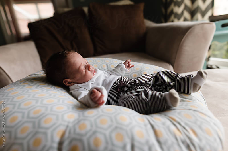 baby sleeping on pillow by Maria Manco for Stocksy United