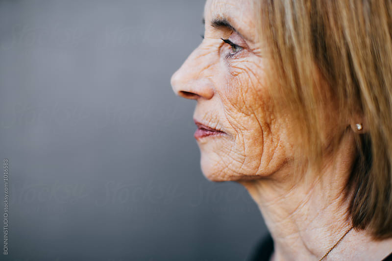 Profile portrait of a wrinkled senior woman. by BONNINSTUDIO for Stocksy United