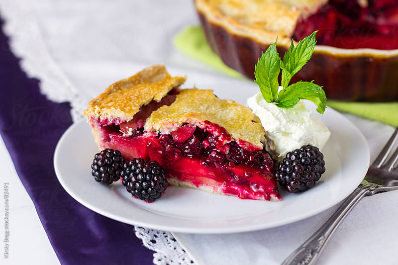 Apple and Blackberry Pie on plate by Kirsty Begg for Stocksy United