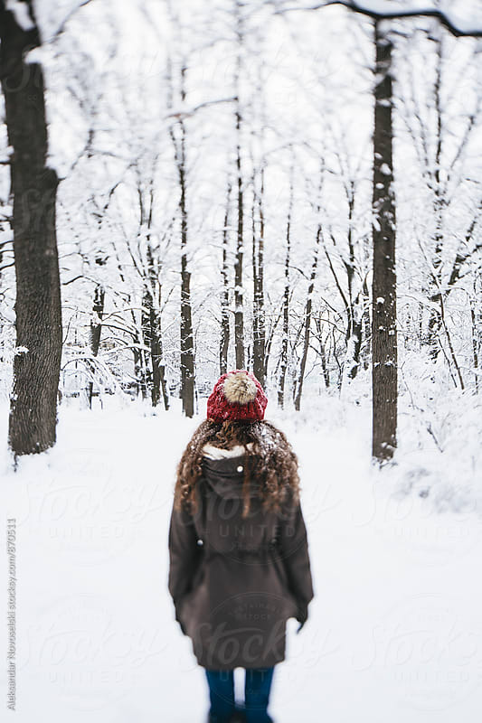 Young woman enjoying the winter landscape, shot from behind by Aleksandar Novoselski for Stocksy United