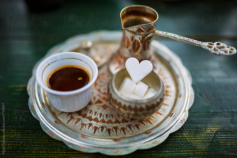 Traditional bosnian coffee on a green table by Maja Topcagic for Stocksy United