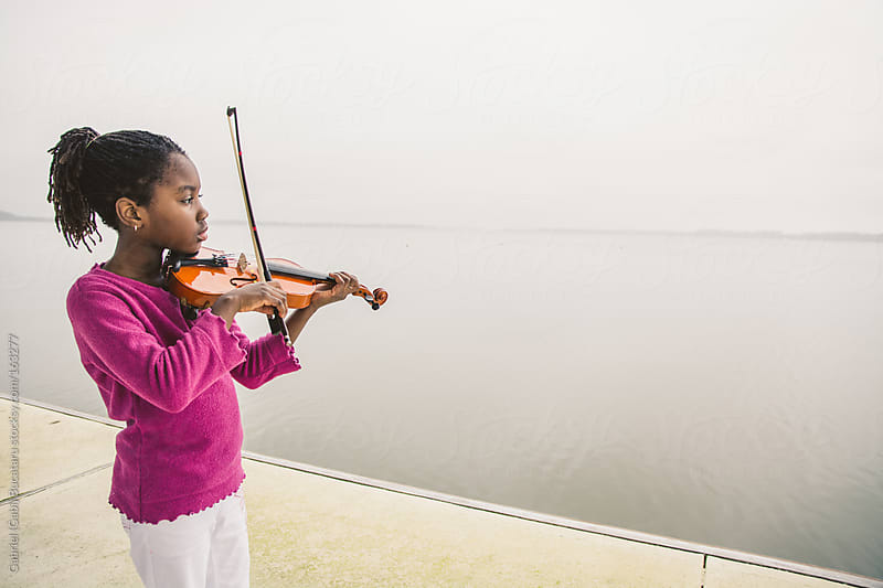 Black Girl with Violin by Gabriel (Gabi) Bucataru for Stocksy United