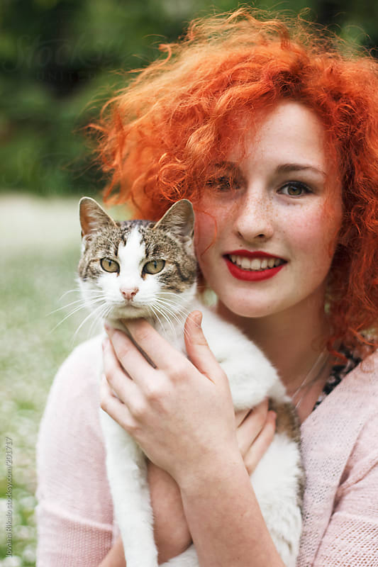 Beautiful ginger woman holding a cat by Jovana Rikalo for Stocksy United