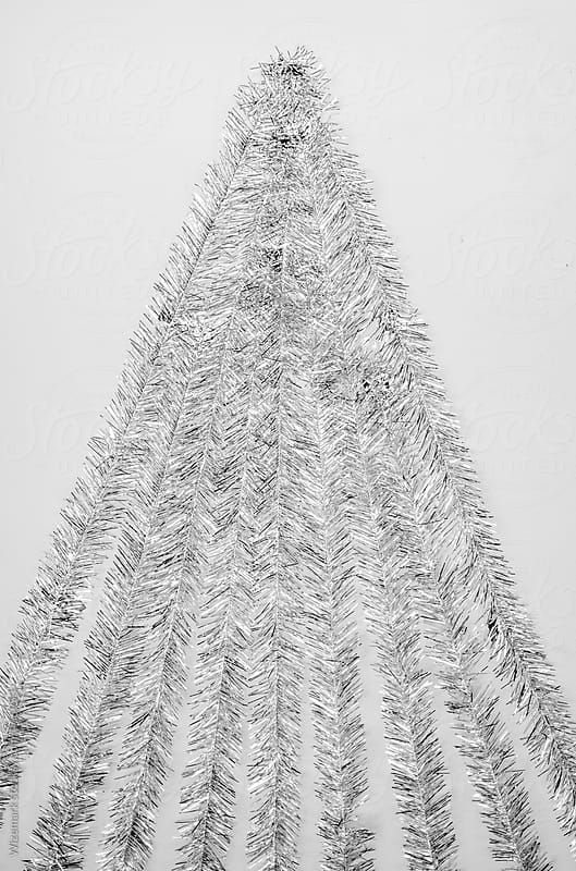 Christmas tree made of curly silver garland/tinsel on a white background by Wizemark for Stocksy United