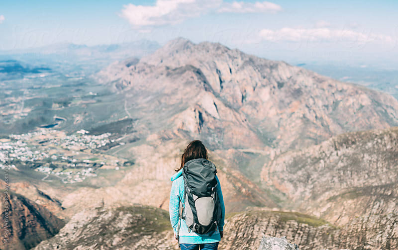 Female Hiker on a mountain summit enjoying the view by Micky Wiswedel for Stocksy United