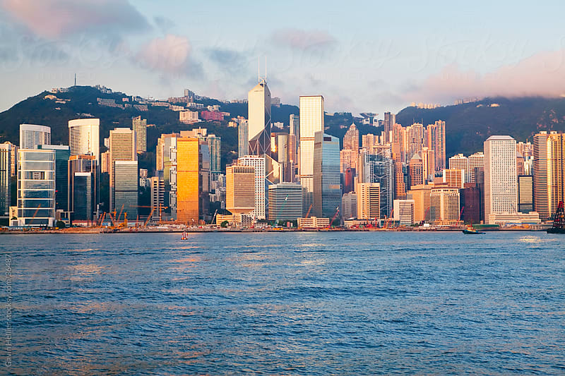 Skyline of Central, Hong Kong Island, from Victoria Harbour, Hong Kong, China, Asia by Gavin Hellier for Stocksy United